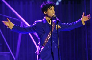 "** FILE ** Prince performs during the 46th Annual Grammy Awards in a Los Angeles, Ca. file photo from Feb. 8, 2004. The ""Purple Rain"" singer will be honored with the 2005 NAACP Vanguard Award in a Los Angeles ceremony.  (AP Photo/Kevork Djansezian, File)"